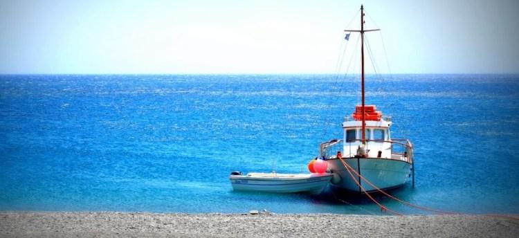 Boat Nikos in beach Forokli suring excursion