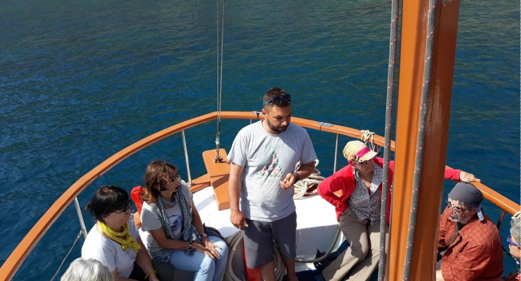 Captain Manolis Orfanos explaining the story of the area during trip.