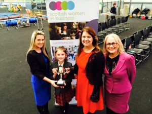 Liz Taylor (SWIB President) presents St Blane's PS with their GOLD Champions for Change Award