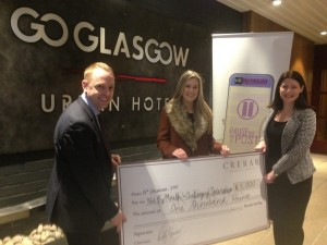Representatives of the Crerar Hotels Trust hand over the donation to NBM's Emma Alexander