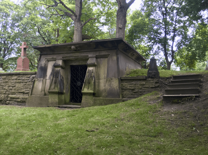 The front of the Gzowski Mausoleum with its stylised columns and winged sun-disk