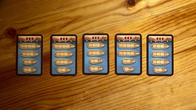 Round cards that show the types of ships available for players this round