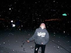 Alex catching snow flakes
