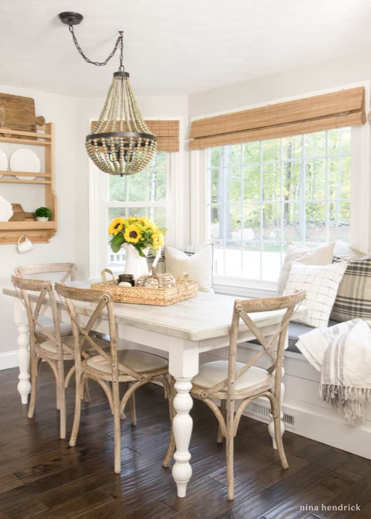 Breakfast nook with sunflowers and plaid pillows
