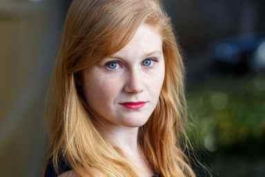 strawberry blonde blue eyed actress headshot outdoors