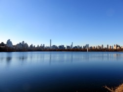The Manhatten skyline as seen from the Reservoir in Central Park.