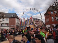 Parade toward ferris wheel