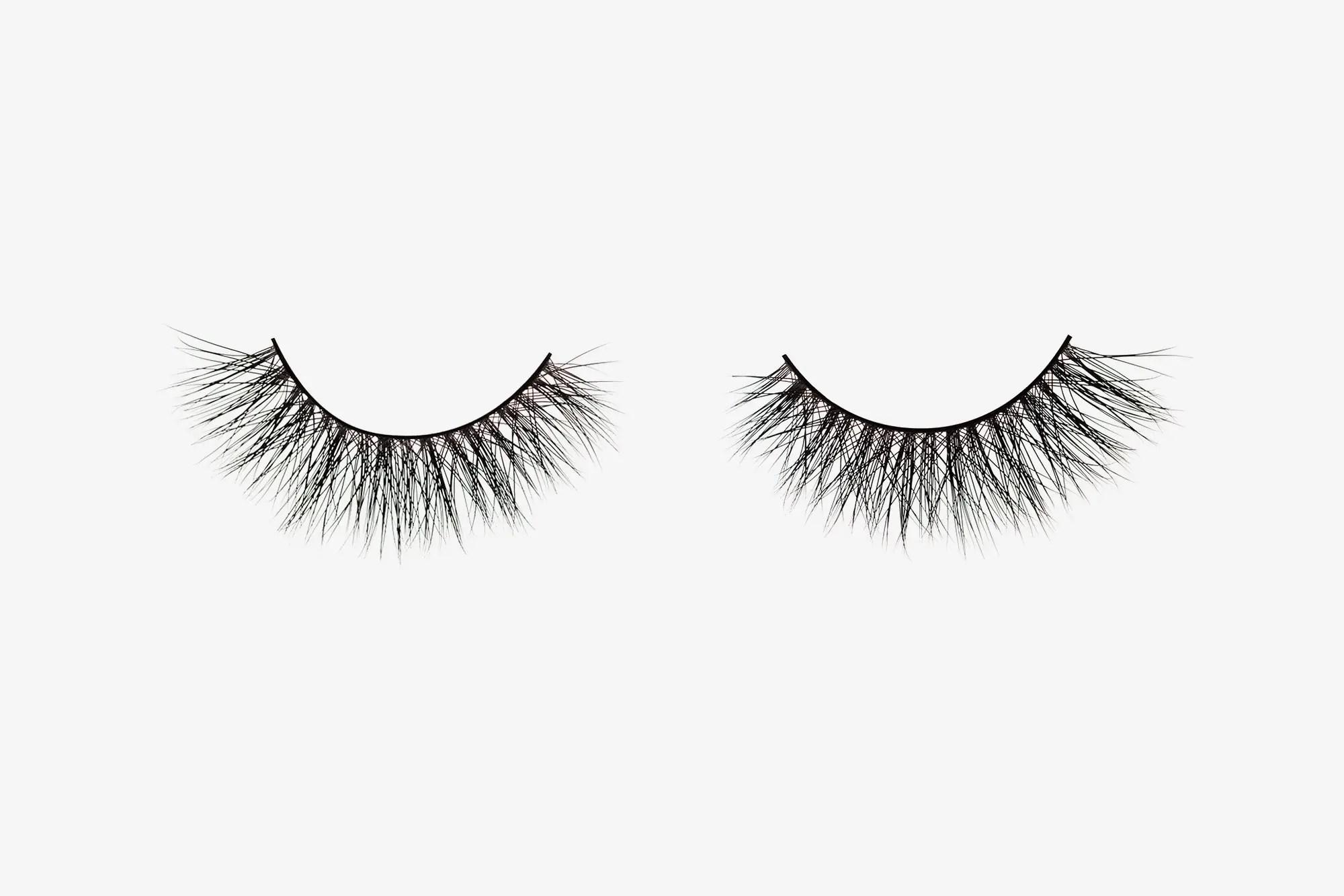 Olivia Mink Lashes, two false eyelashes side by side on grey background