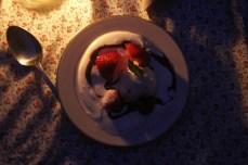 a candlelit dessert