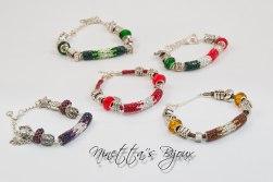 bracciale con perle foro largo e tubo con strass, disponibile in vari colori