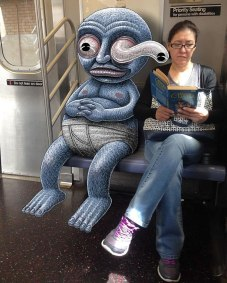 artist-adds-monsters-next-to-strangers-on-the-subway-10