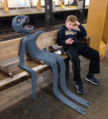 artist-adds-monsters-next-to-strangers-on-the-subway-27