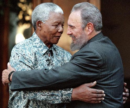 File photo of Cuba's President Fidel Castro and former South Africa's President Mandela in Johannesburg