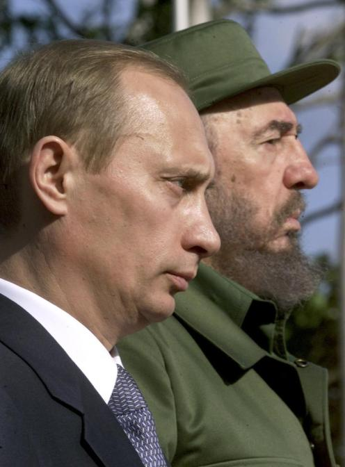 File photo of Russia's President Putin and Cuba's President Fidel Castro stand side by side in Havana