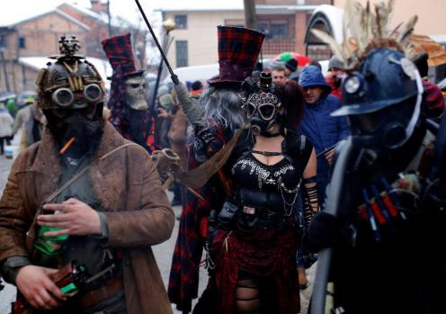 Revelers participate in a parade on the streets during a carnival to mark the annual Orthodox St. Vasilij Day in the village of Vevcani, south of the Macedonian capital of Skopje. REUTERS/Ognen Teofilovski