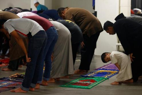 Muslims perform tarawih prayers to mark the start of Ramadan at a mosque in Singapore