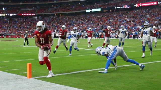 Larry Fitzgerald scores a touchdown for NFC West side Arizona Cardinals