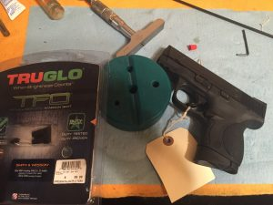 M&P pistol on the bench waiting on night sight installation