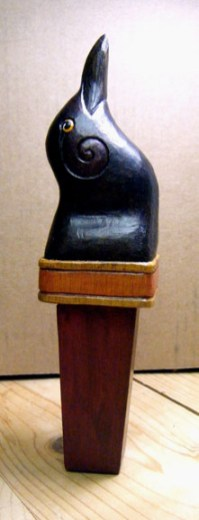 Hand carved crow beer tap handle.