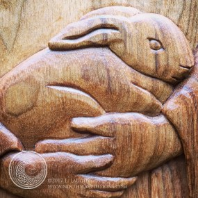Detail of the St. Francis Icon carving in butternut wood.