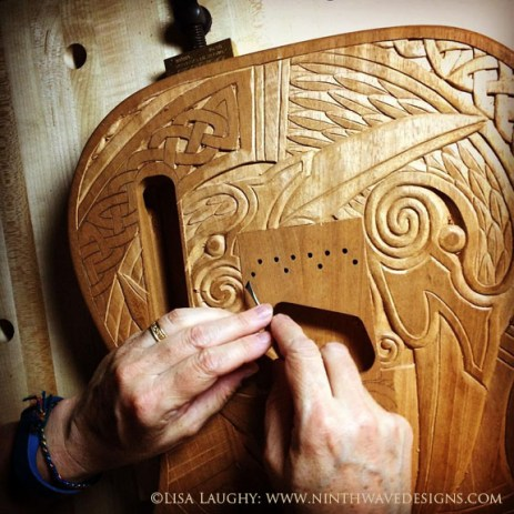 Carving some of the fine detail with a micro carving tool.