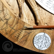 Drawing runes and oak leaf medallion on the border.