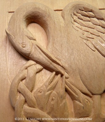 Detail of the pelican shield carving.