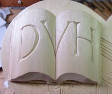 The open book with DVH initials.
