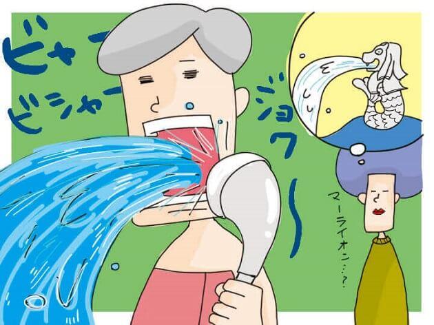 口の中にシャワーの見ずを浴びせて濃栓を取ろうとする様子