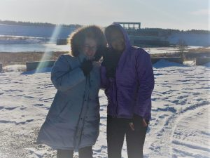 Lion Gerri Madill of Saskatoon and International Director Nicolin Carol Moore of Trinidad and Tobago brave the cold at the Nipawin Hydroelectric Dam Lookout Point November 24.