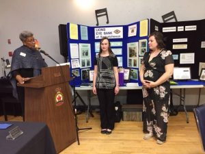 The newest member of the Nipawin Lions Club, Jessie Ruel (right) is inducted during a ceremony conducted by International Director Nicolin Carol Moore. At center is Jessie's sponsor Ashton Bernesky.