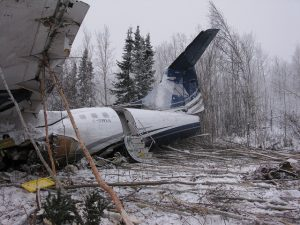 Transportation Safety Board of Canada - Left side view – back of aircraft wreckage showing aft left passenger door