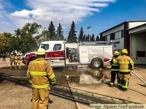 """""""Wet it down and Push it in"""" ceremony for the commissioning of the new Melfort Fire & Rescue Fire Truck"""