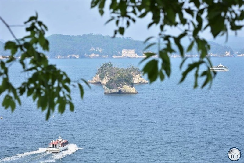 A ferry boat approches an island in Matsushima bay.