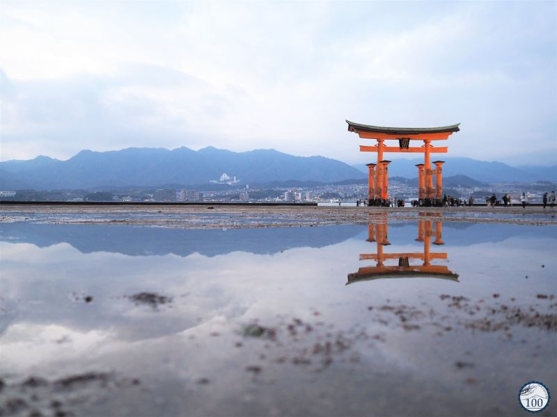Itsukushima big torii reflection in Miyajima bay.
