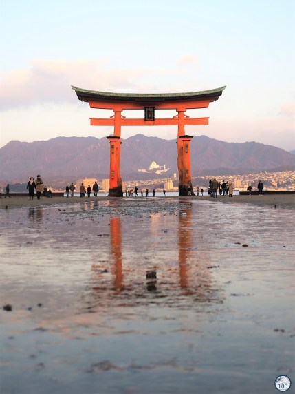 Itsukushima torii attracts many visitors at low tide.