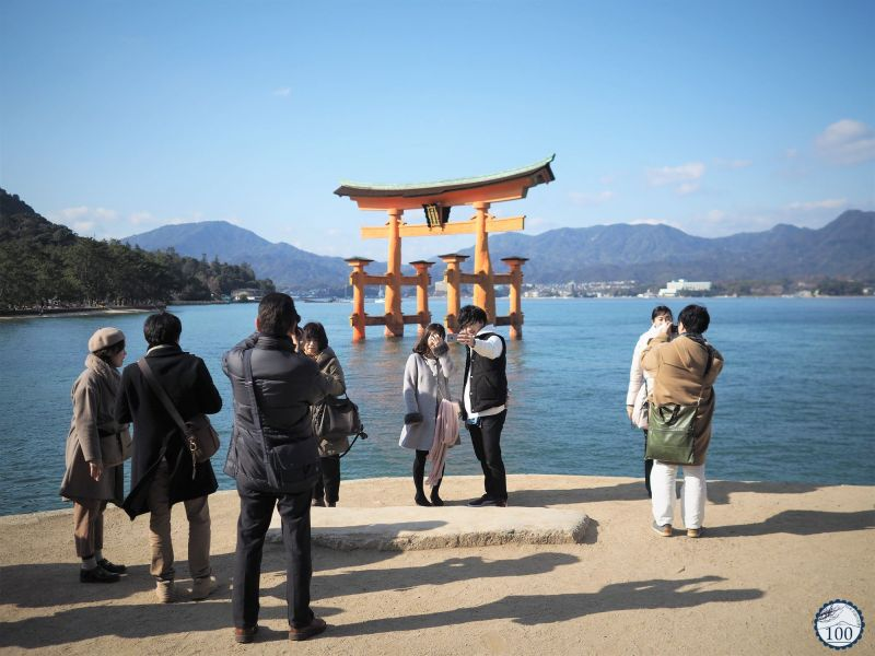 Classical photo shooting in front of the floating torii of Itsukushima.