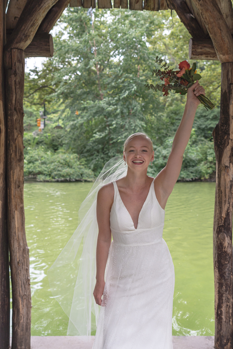 A happy Kat Gaffney smiles for the camera under the pavilion of Wagner Cove.