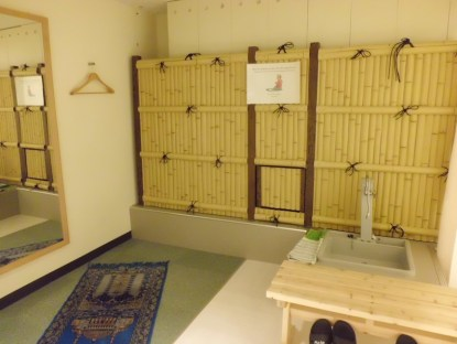 Men's space. Wudhu tap, prayer mats, and slippers are available.