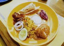 The main course- biryani, chicken, and pappad