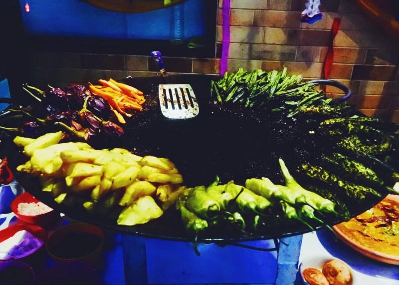 The veggies sizzling on the tawa