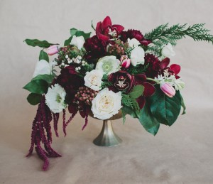 Burgundy floral centerpiece with gray stand