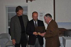 John Hook and Vince Verbeke present Tom Smyth his plaque