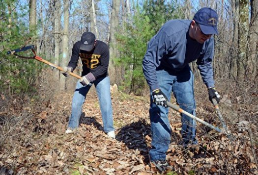 Bernie and Steve clearing brush away from the overgrown trail.