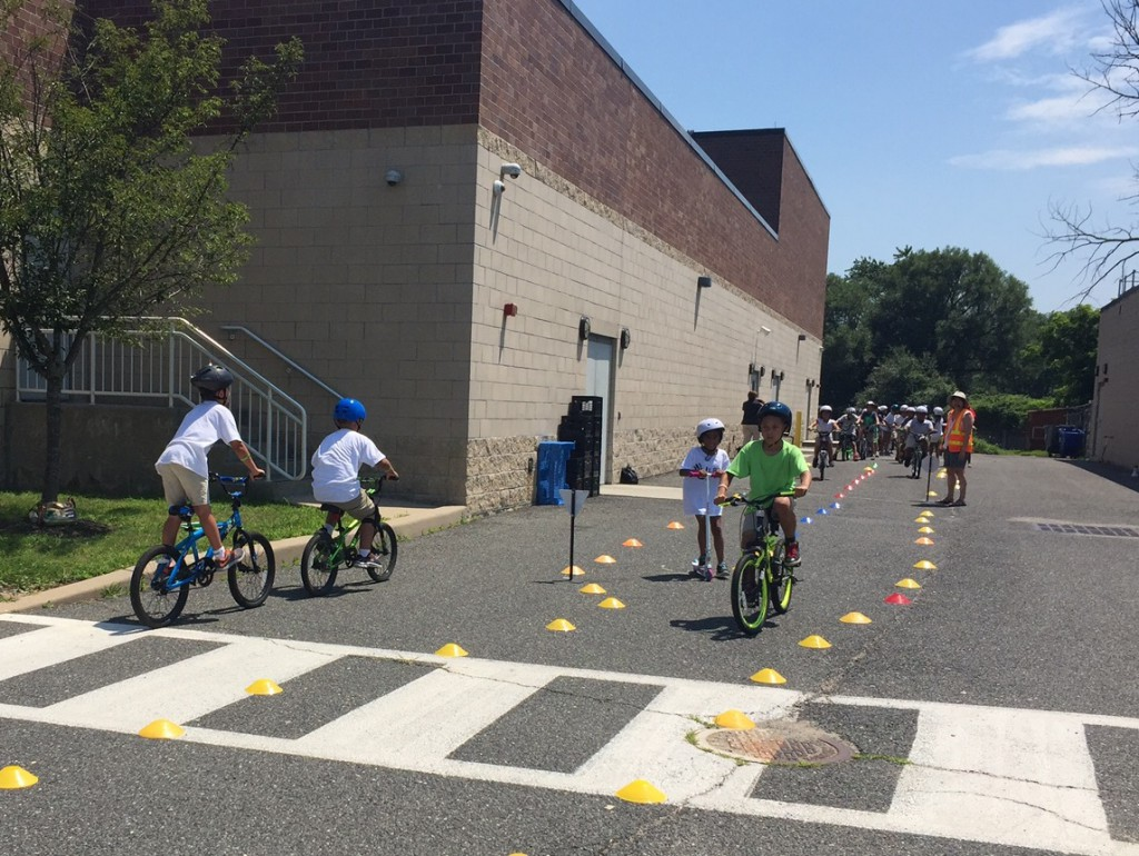 Children learning to start, stop, and yield at Anastasia Amerigo Elementary.