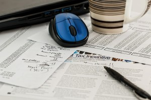 Picture of tax forms on a desk.