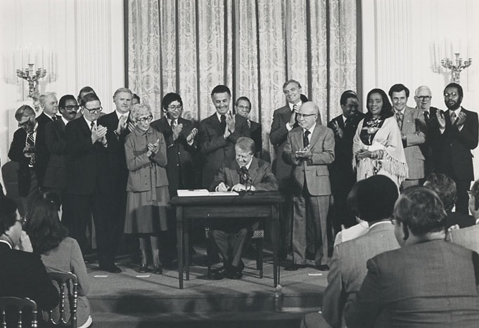 President Carter signing the Humphrey--Hawkins Full Employment and Balanced Growth Act of 1978