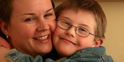 Future fears: Catherine McAlpine with one of her three sons, Julian, who has Down syndrome. Photo: Penny Stephens