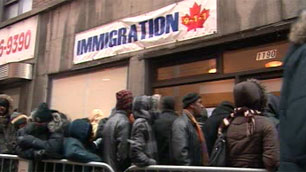 People of Haitian origin queue outside a Montreal immigration firm that promises to help accelerate the immigration process for those affected by last week's earthquake.  (CBC)