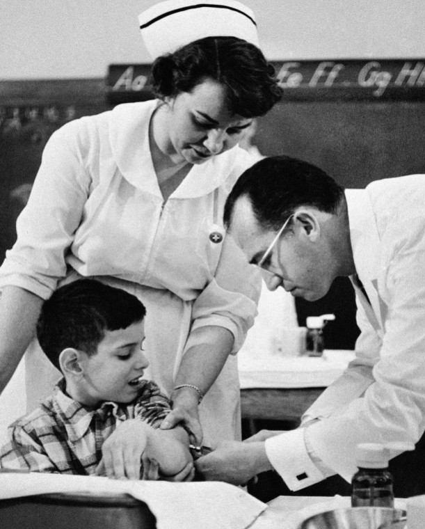AP Photo/National Foundation March of Dimes Dr. Jonas Salk administers a trial polio vaccine to David Rosenbloom of Pittsburgh in this 1954 photo. The HeLa cells were used in the research that led to the vaccine.